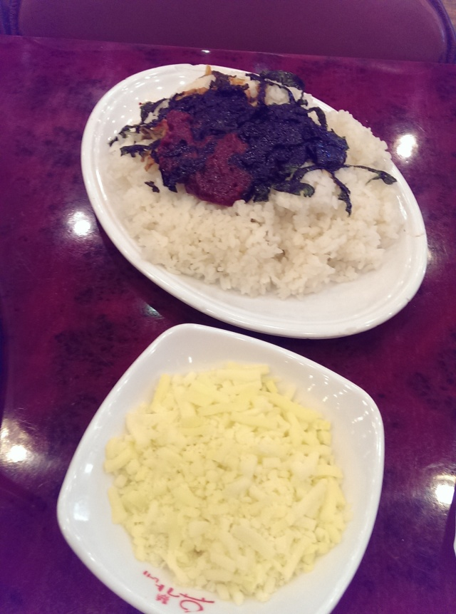 rice, seaweed  and chili sauce in one dish and mozzarella cheese in another